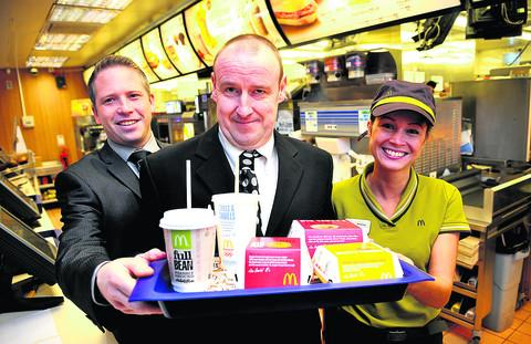 From left, Neil Laybourne, the manager of McDonalds in Great Western Way, with David Boote and Andressa Diniz