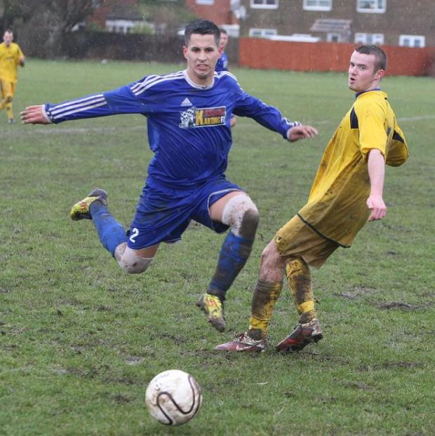 Madames' Kieran Jennings, left, in action against Chippenham Park