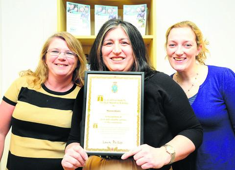 Maurizia Quarta, centre, and colleagues Janis Grafton, left, and Joanna Hiller-Culley with the award she received from the High Sheriff of Wiltshire