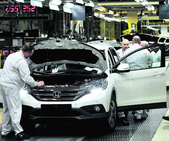 This Is Wiltshire: FACING JOB LOSSES Workers on the Honda CR-V production line at the Honda Plant in Swindon, pictured last year