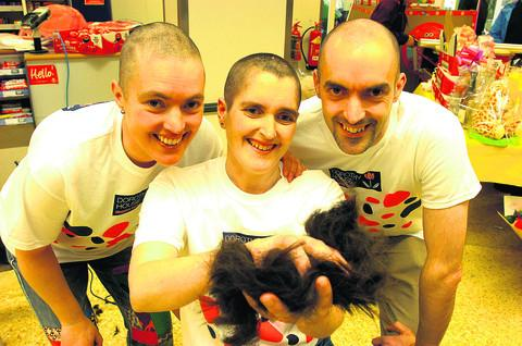 This Is Wiltshire: Karen Doling with brother Roger and sister Jo after their head shaves