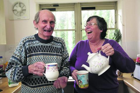 This Is Wiltshire: Jackie Mason receives the congratulations of fellow Elizabeth House resident John Brosnan