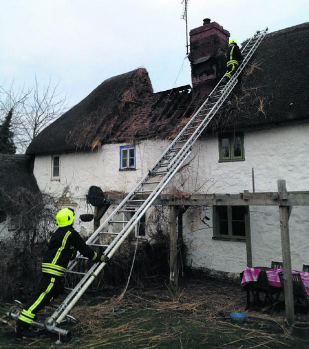 This Is Wiltshire: Firefighters at the scene of yesterday's blaze