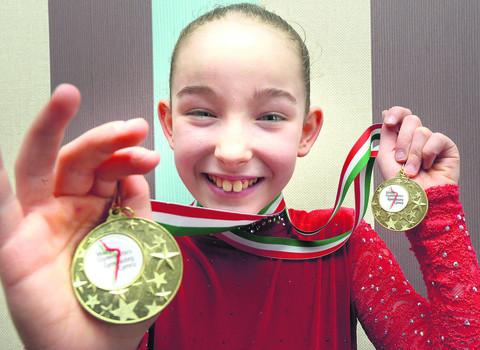 This Is Wiltshire: Abi-Jae Booth with some of her gymnastics medals