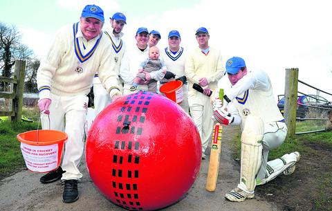 This Is Wiltshire: Members of the Swindon United Churches Cricket Club with their giant cricket ball, from left, David Martin, Joe Hatherall, Duncan Mead with Thomas Mead, Richard Martin, James Mann, Bob Butcher and Dan Hunt