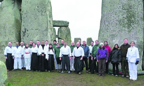 This Is Wiltshire: Centre front, senior instructor Matt Hill of Wiltshire Martial Arts, left, and Paul Sparks, instructor for North West Wiltshire Martial Arts, and group members at Stonehenge