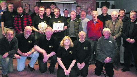 This Is Wiltshire: Members of the Regional 10 prize-winning Trowbridge and District Amateur Radio Club, gathered together to celebrate their victory, but they are now awaiting the result of the national competition to find the year's best radio club