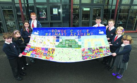 This Is Wiltshire: The banner made by pupils at Rowde Primary School