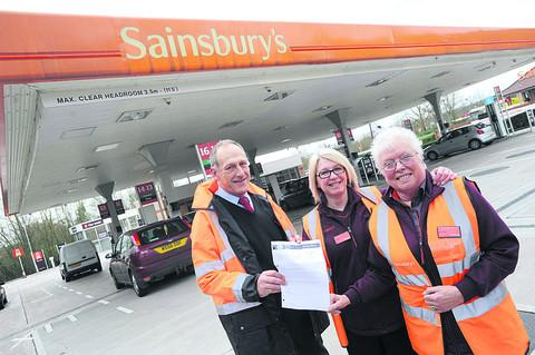 This Is Wiltshire: Sainsbury's deputy manager Dave Owen with members of staff Andrea Edwards and Lyn Wootton on the forecourt, reading the letter of praise