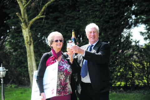 This Is Wiltshire: John and Pauline Alford celebrating their lottery win today. Pictures by Trevor Porter