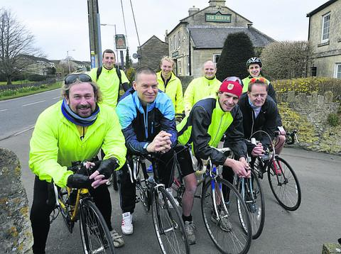 This Is Wiltshire: Cricketers riding off on their fundraising trip from the pub in Bradford on Avon to Poole and Yeovil