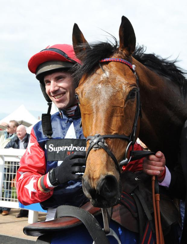 This Is Wiltshire: Godsmejudge, pictured with jockey Wayne Hutchinson after winning last year's Scottish Grand National