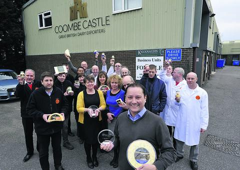 This Is Wiltshire: Coombe Castle International managing director Darren Larvin, front, with his jubilant staff