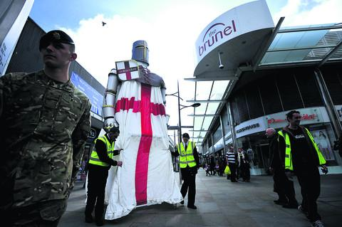 This Is Wiltshire: A 20ft figure of St George is to return to the town centre next week