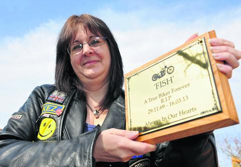 This Is Wiltshire: Simon Fisher's partner partner  Kerrie Dixon has had a plaque made in tribute to him, which has been placed at the Old Nick pub in Royal Wootton Bassett