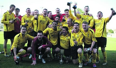 This Is Wiltshire: Melksham Town celebrate winning the Wiltshire Senior Cup (Picture by Robin Foster)