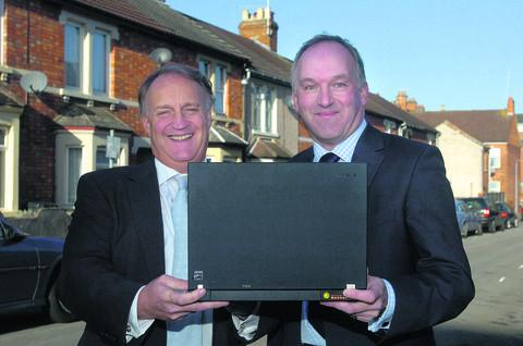 This Is Wiltshire: Rickki Hunt and then Council Leader Rod Bluh launch the doomed wi-fi project in 2009