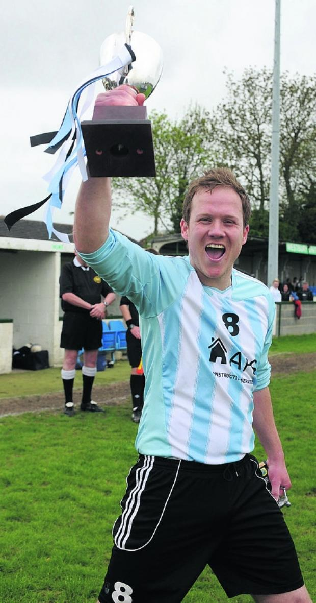 This Is Wiltshire: Biddestone Social captain Danny Jones lifts the Subsidiary Cup to complete his side's historic quadruple last season
