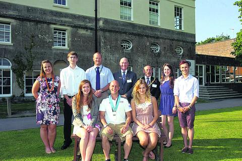 This Is Wiltshire: At the opening of the new sixth form are, front, Jazmin Russ, Olympian Pete Waterfield, Bronte Newstead, and back deputy head of sixth form Amy Pearce, Tom Bright, sixth form head Glyn Evans, headteacher Malcolm Irons, town mayor Pete Smith, Grace Farrell