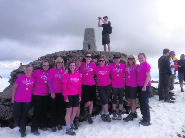 This Is Wiltshire: Anita Hodgson, Karen Brown, Tina Mead, Linda Roberts, Jayne Gaffney, Kelly Gaffney, Mary Harris, Clare McAtear, Stephanie Mundy and Claire Stevenson at the peak of Ben Nevis