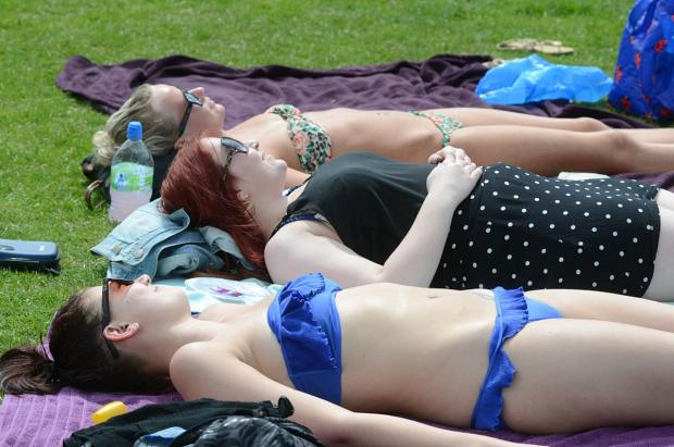 This Is Wiltshire: Sunbathers are warned to use sunscreen and wear sunglasses if outdoors for more than 20 minutes