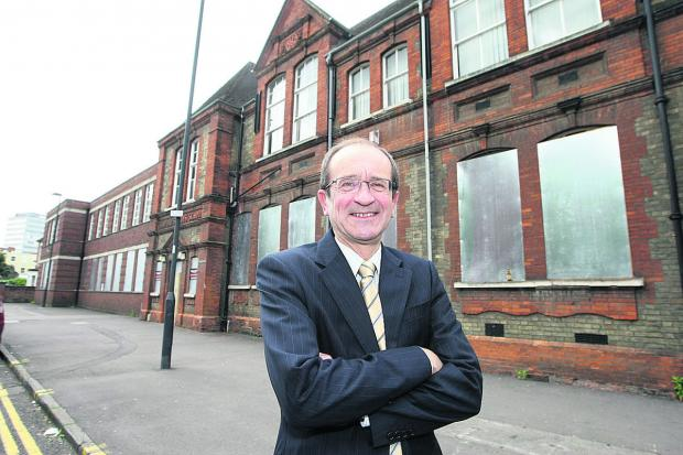 This Is Wiltshire: Coun Brian Mattock, outside Sandford House in the town centre