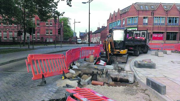 This Is Wiltshire: Regent Circus roadworks which caused damage to a car