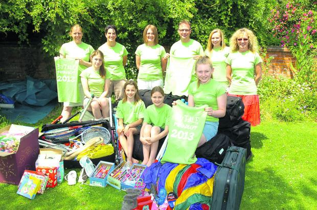 This Is Wiltshire: Preparing for the trip, back row, from left, Miriam Sawyer, Julia Childerhouse, Jo Millward, Dave Sawyer, Lydia Hayward and Mandy Bush. Front, Lucy and Beth Sawyer, Becca Childerhouse and Abby Millward