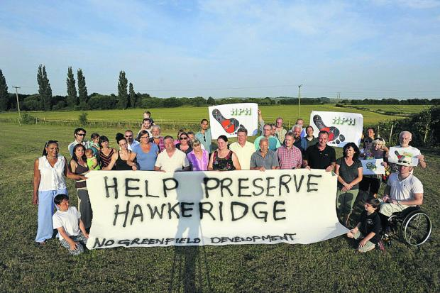 This Is Wiltshire: Protesters against the proposed 35-acre business park at Hawkeridge. The plan has now been approved