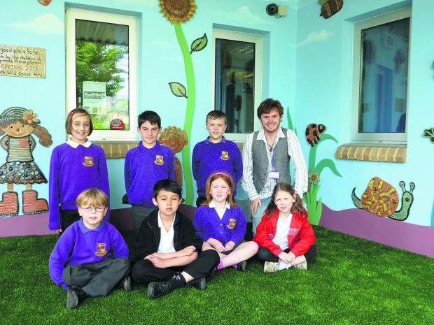 This Is Wiltshire: Artist Josh Simpson with pupils of Fynamo