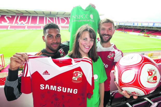 This Is Wiltshire: NSPCC fundraising manager Anna Keir with Town players Wes Foderinhgam and Darren Ward