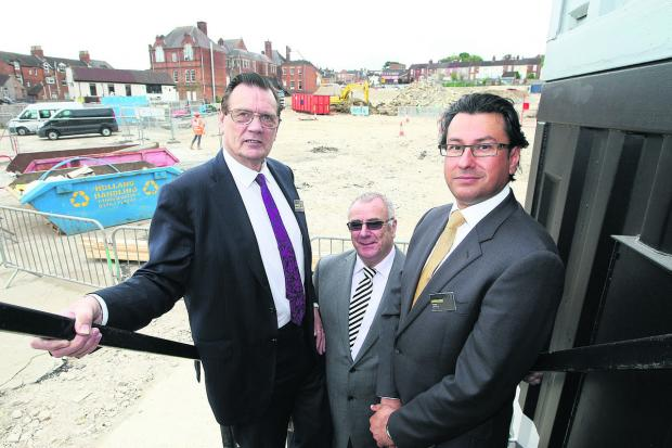 This Is Wiltshire: From left, Coun Garry Perkins, the Cabinet member for economy, regeneration and culture, Gareth Davies, ISG project director  and the director of Ashfield Land, Paul Jagroop, at the the Regent Circus development on the former Swindon College site