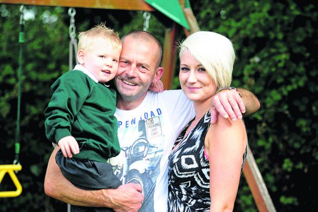 This Is Wiltshire: Loui Crowther with his dad and mum, Mark and Kayleigh