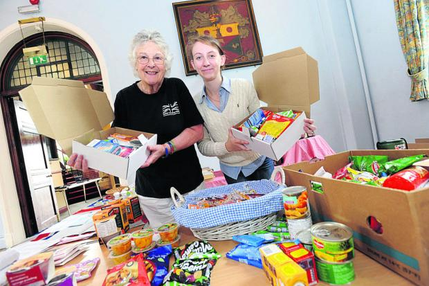 This Is Wiltshire: From left are Nickie Phillipson-Stoy and organiser Ellie Vesey-Thompson, packing goods for troops                  (DV623) By DIANE VOSE