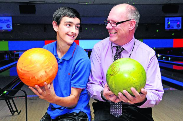 This Is Wiltshire: Mentor Paul Brown spends two hours a week with 15-year-old Aiden Park, taking him bowling and swimming