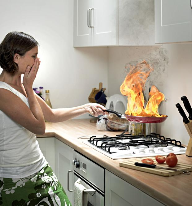 This Is Wiltshire: Would you know what to do? The dangers of deep fat frying and burning frying pans are being highlighted by Wiltshire Fire & Rescue Service. Picture posed by model