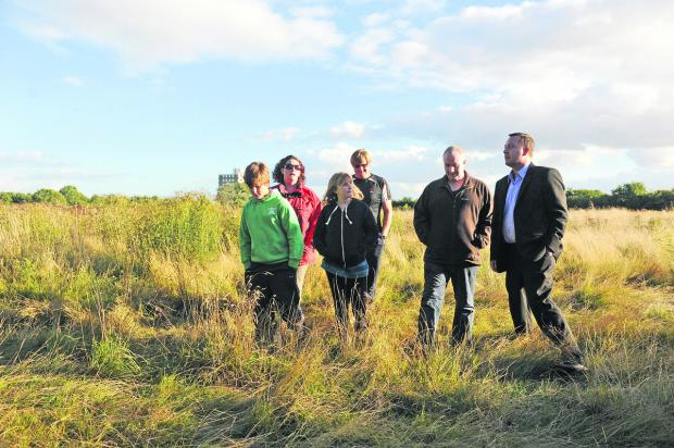 This Is Wiltshire: Coun Dale Heenan, right, with some residents at a proposed site in Greenbridge. Left to right are Edward, Geraldine and Samantha Brant with Freddie the dog, Wayne Street, Bob Burton and Dale Heenan