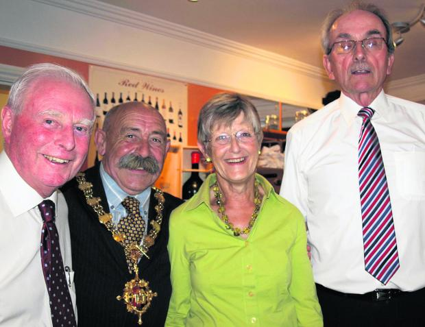 This Is Wiltshire: Devizes Food and Drink Festival chairman Sally McClelland with Devizes mayor Pete Smith, retiring treasurer Tom Fussell, left, and David Fruen, right, representing Dorothy House Hospice Care