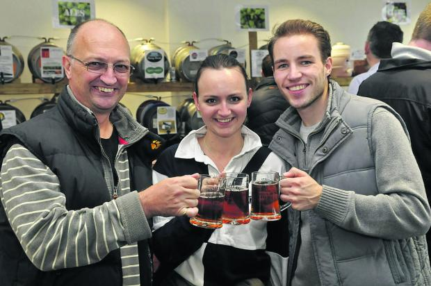 This Is Wiltshire: Jon and Rebecca Munton with Andrew Green at the beer festival in Royal Wootton Bassett