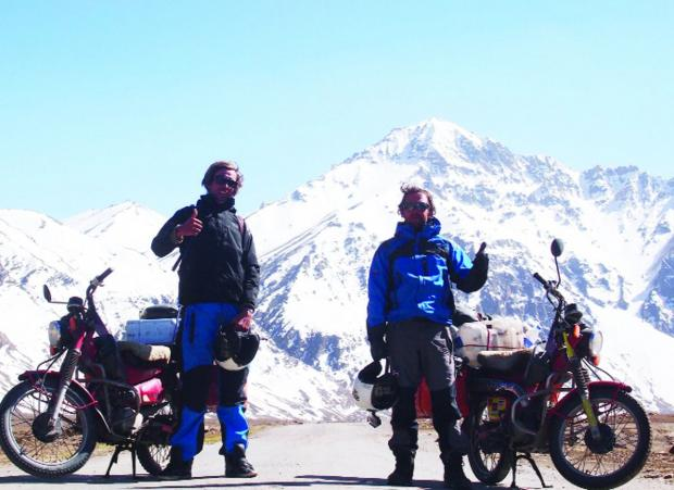 "This Is Wiltshire: Top of the world – Laurence, left, and Sam are pictured with their trusty Australian postal service bikes in the Himalayas where they rode the world's highest motorable road. ""The scenery was breathtaking,"" says Laurence"