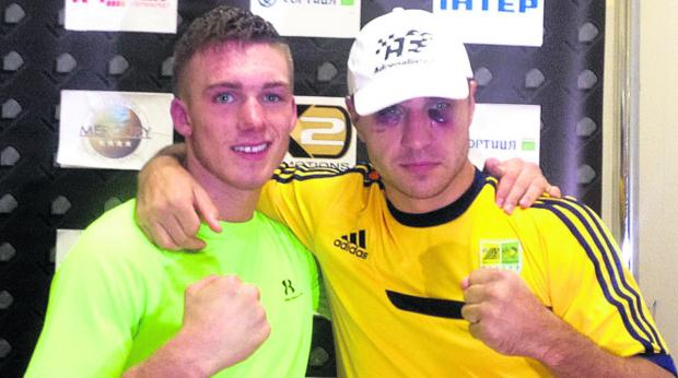 This Is Wiltshire: Nick Blackwell, left, with badly-bruised victor Max Bursak after their fight in the Ukraine