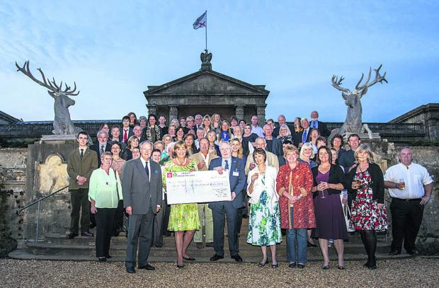 This Is Wiltshire: Lord and Lady Lansdowne, centre with Mike Weston, hand over cheques