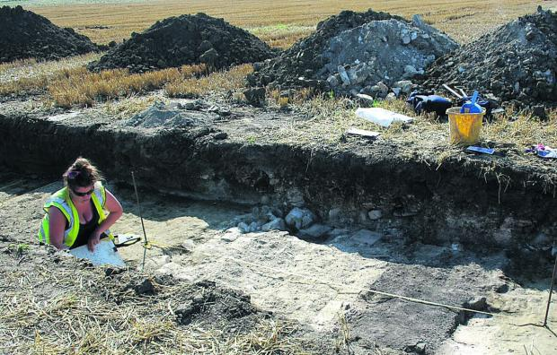 This Is Wiltshire: An archaeologist at work on the site where it is thought there was a Roman villa