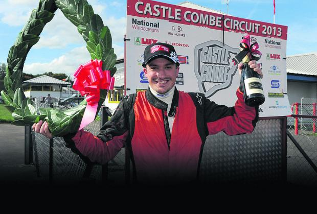This Is Wiltshire: Adam Higgins celebrates his Formula Ford 1600 Championship triumph last year