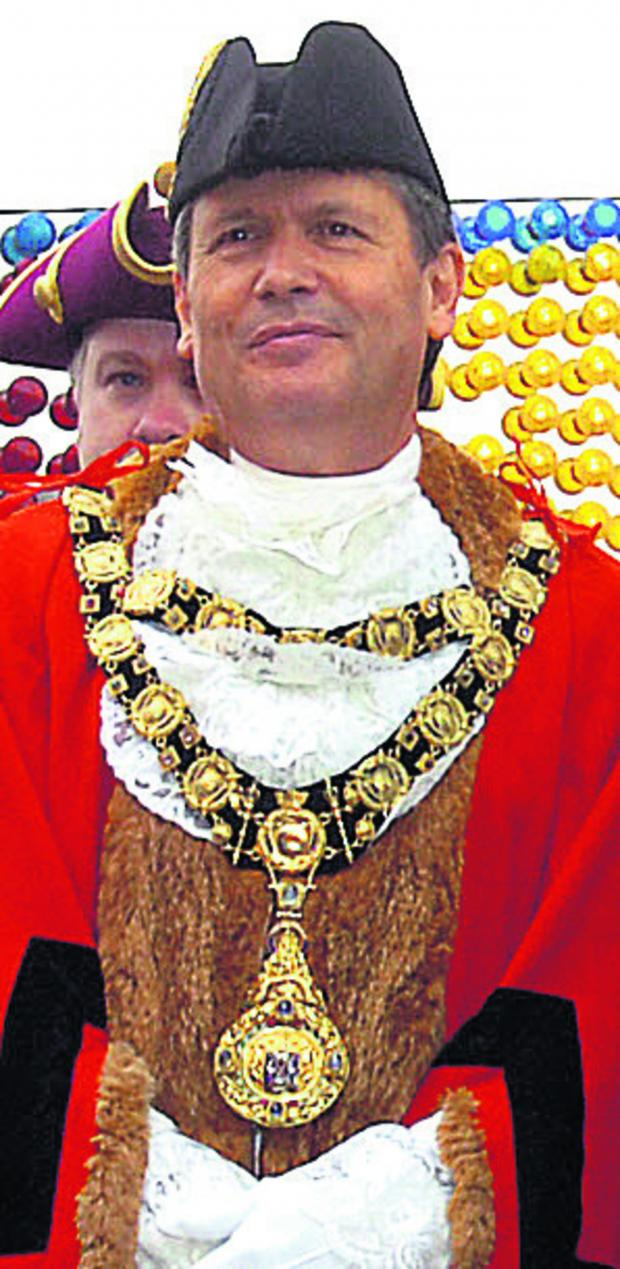 This Is Wiltshire: Marlborough mayor Guy Loosmore wearing the stolen ceremonial chains at the opening of the town's mop fair