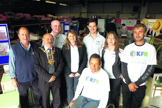 This Is Wiltshire: The Refurbiz team pictured at a recent open day with Devizes Mayor Pete Smith, second left, and Andrew Farrow, front