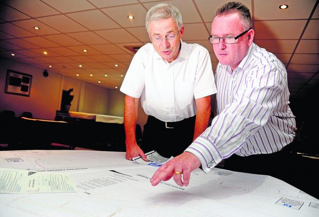 This Is Wiltshire: Bob Sanders and Mark Walker look over some of the proposals to deal with the parking