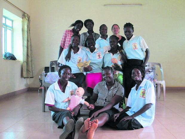 This Is Wiltshire: Midwife Becky Millar, inset, visited Southern Sudan, where she helped train nurses in the antenatal clinic
