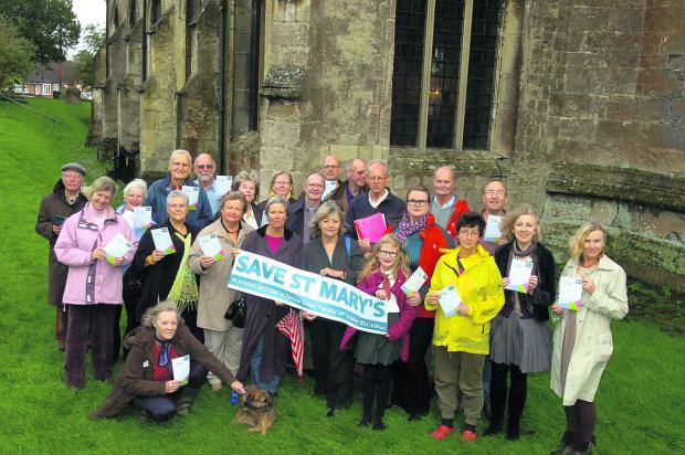 This Is Wiltshire: St Mary's Church campaigners who want planners to approve a scheme for an extension to the 12th-century building
