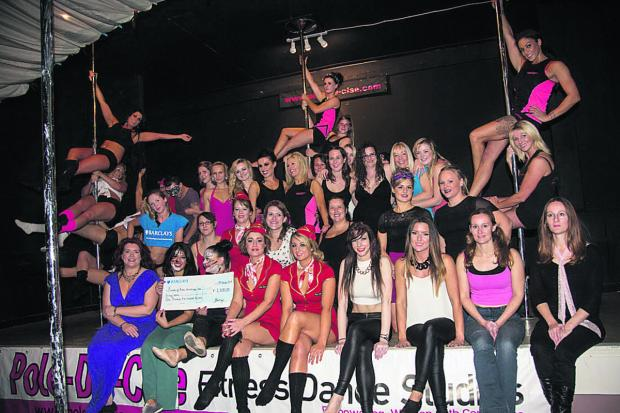 This Is Wiltshire: Pole-Da-Cise fitness dance studios members with a cheque for £1,500 from Wiltshire branches of Barclays Bank  Photo: Loveday Powell Photography